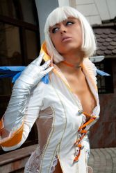 1girl blue_eyes breasts cosplay dark_skin devil_may_cry devil_may_cry_4 gloria photo short_hair solo standing white_hair