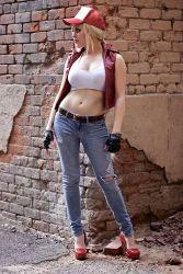 1girl blonde_hair cosplay denim fatal_fury fingerless_gloves genderswap hat high_heels jeans midriff navel non-asian photo ponytail snk solo tank_top terry_bogard terry_bogard_(cosplay) torn_jeans vest
