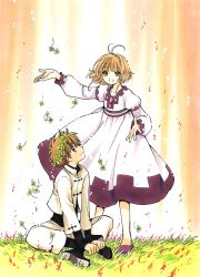1boy 1girl absurdres brown_eyes brown_hair clamp dress eye_contact green_eyes highres indian_style looking_at_another outdoors sakura_hime short_hair sitting tsubasa_chronicle xiaolang