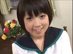 1boy 1girl abuse animated animated_gif female flower indoors photo plant school_uniform serafuku short_hair slap smile solo solo_focus source_request uniform upper_body