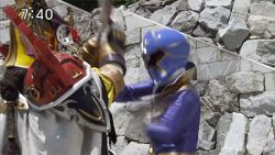 1girl 3boys animated animated_gif fighting multiple_boys photo super_sentai sword violence weapon