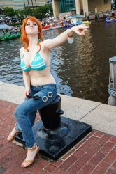 1girl bikini_top breasts cosplay denim feet flaming-goddess jeans large_breasts nami_(one_piece) nami__(one_piece)_(cosplay) non-asian one_piece orange_hair photo pointing sitting solo