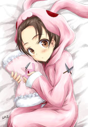 1girl animal_costume bangs bed blush brown_eyes brown_hair bunny bunny_costume closed_mouth emblem girls_und_panzer holding hooded_pajamas knife long_sleeves looking_at_viewer lying on_side onesie parted_bangs pillow pink_pajamas sawa_azusa saz saz_(sazin764) short_hair solo
