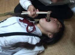 1boy 1girl animated animated_gif black_hair chopsticks food food_in_mouth hoshino_yuuna japanese long_hair lying nhdt-455 open_mouth photo soba twintails