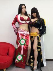 2girls asian boa_hancock boa_hancock_(cosplay) breasts cosplay hitomi_tanaka huge_breasts japanese multiple_girls okita_anri one_piece photo