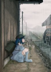 1girl aki_tsui backpack bag blue_eyes blue_hair boots full_body hair_bobbles hair_ornament hat highres kawashiro_nitori looking_up on_ground profile puffy_sleeves rain rubber_boots shirt short_sleeves sitting skirt skirt_set solo touhou twintails water