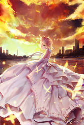 1girl artist_name blonde_hair bridge butterfly city cityscape cloud cloudy_sky dress elbow_gloves fate/stay_night fate_(series) gloves green_eyes highres lamppost light_particles looking_to_the_side magicians_(zhkahogigzkh) orange_sky reflection river saber sky smile solo sunset tagme tower wedding_dress white_dress