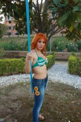 1girl bikini breasts cosplay jeans large_breasts nami nami_(cosplay) one_piece orange_hair photo solo standing