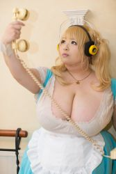 1girl asian blonde_hair breasts brown_eyes cleavage cosplay fat headphones hoshima_mika huge_breasts jewelry necklace nitroplus photo solo star super_pochaco super_pochaco_(cosplay) twintails