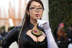 1girl asian bayonetta breasts cosplay crescent_moon earrings female glasses highres lollipop photo solo tagme upper_body