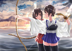 2girls absurdres akagi_(kantai_collection) archery arrow black_legwear blue_hakama bow_(weapon) brown_hair cloud cloudy_sky drawing_bow gloves hakama hakama_skirt highres japanese_clothes kaga_(kantai_collection) kantai_collection multiple_girls muneate nodokana_yuki ocean partly_fingerless_gloves red_hakama short_hair side_ponytail sky smile sunset weapon