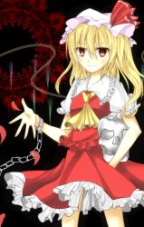 >:) 1girl ascot blonde_hair blush carrying_under_arm chains collar cowboy_shot crystal cuffs flandre_scarlet frilled_collar frilled_skirt frilled_sleeves frills hat hat_ribbon highres long_hair looking_at_viewer mob_cap moko-rinn older puffy_short_sleeves puffy_sleeves red_eyes red_ribbon red_shirt red_skirt ribbon shackles shirt short_sleeves side_ponytail skirt skirt_set skull smile solo touhou tsurime wings