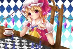 1girl argyle argyle_background aru0607 ascot blonde_hair board_game chair chess chess_piece chessboard cup dutch_angle elbow_rest expressionless flandre_scarlet gradient gradient_background head_rest light_particles looking_at_viewer mob_cap puffy_short_sleeves puffy_sleeves red_eyes saucer short_hair short_sleeves side_ponytail sitting solo table teacup touhou wings wrist_cuffs