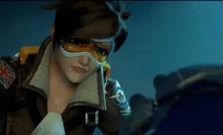 2girls animated animated_gif bodysuit brown_hair english goggles long_hair naughty_face open_mouth overwatch parody ponytail purple_hair short_hair smile spandex subtitled teeth tracer_(overwatch) vest widowmaker_(overwatch) yellow_eyes yuri
