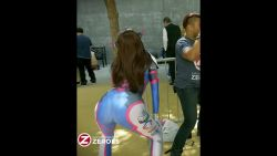 3girls 5boys animated animated_gif ass ass_shake bodysuit brown_hair cosplay curvy d.va_(overwatch) d.va_(overwatch)_(cosplay) dancing from_behind huge_ass latex long_hair multiple_boys multiple_girls outdoors overwatch photo pov_ass public shiny skin_tight solo_focus thick_thighs tree twerking vamplette wide_hips