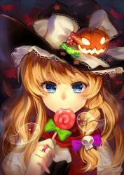 1girl blonde_hair braid candy hair_ornament halloween hat highres jack-o'-lantern kirisame_marisa kyuri_(405966795) lollipop long_hair skull_hair_ornament solo star touhou witch_hat