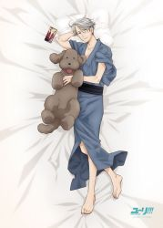 1boy artist_request blue_eyes cellphone copyright_name dakimakura dog japanese_clothes kimono lying makkachin male_focus official_art on_back phone pillow silver_hair smartphone smile tongue tongue_out viktor_nikiforov yukata yuri!!!_on_ice
