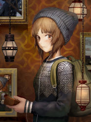 1girl absurdres backpack bag bandage bangs beanie blush breasts brown_eyes brown_hair cable chains closed_mouth cross earphones fingernails frame from_side girls_und_panzer hat highres holding indoors lantern long_sleeves looking_at_viewer matching_hair/eyes nishizumi_miho photo_(object) short_hair sleeves_past_wrists solo tomiya_(tomiya2117) upper_body wall wallpaper