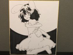 1girl absurdres animal_ears barefoot bunny_ears bunny_tail carrot_necklace clenched_hands dark_background dress futa4192 greyscale hair_between_eyes highres inaba_tewi leg_up looking_at_viewer looking_back monochrome open_mouth photo puffy_short_sleeves puffy_sleeves shikishi short_hair short_sleeves sketch smile solo tail touhou traditional_media white_background