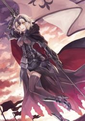 1girl ahoge armor armored_boots armored_dress bangs black_legwear boots cape dutch_angle fate/grand_order fate_(series) flag fur gauntlets headpiece jeanne_alter looking_at_viewer miyakure parted_lips ruler_(fate/apocrypha) short_hair smile solo thighhighs white_hair yellow_eyes