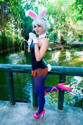 1girl belt bridge bunny_ears bunny_tail bunnysuit collar cosplay dy_chan glove high_heels league_of_legends outdoor pantyhose photo riven_(league_of_legends) river spandex tail white_wig wig