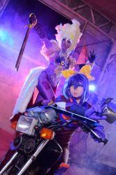 2girls card cosplay lunalight_leo_dancer motorcycle multiple_girls photo purple_hair serena_(yuu-gi-ou_arc-v) two-tone_hair yu-gi-oh! yuu-gi-ou_arc-v