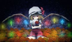 1girl blonde_hair crossed_arms dress flandre_scarlet glowing glowing_wings hat hat_ribbon mob_cap object_hug puffy_short_sleeves puffy_sleeves red_dress red_eyes ribbon short_sleeves sitting skull smile solo torso_(pixiv) touhou wariza wings