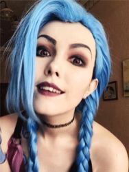 1girl animated blue_hair cosplay jinx_(league_of_legends) league_of_legends lipstick long_hair looking_at_viewer makeup naughty_face smile twintails