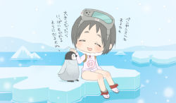 1girl bird black_hair chibi diving_mask eyes_closed glacier goggles goggles_on_head ice kantai_collection maru-yu_(kantai_collection) open_mouth patting_head penguin pqmoshi school_swimsuit short_hair sitting solo swimsuit tachiki_(naruki)