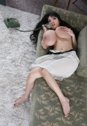 1girl asian bangs barefoot black_hair breast_grab breasts couch dress dress_pull feet grabbing huge_breasts indoors large_areolae long_hair lying nail_polish nipples on_back phone photo red_nails solo tanaka_hitomi