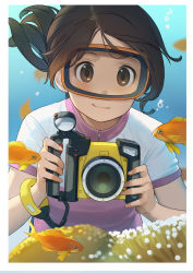 1girl :t bangs border brown_eyes brown_hair bubble camera commentary coral coral_reef eyebrows eyebrows_visible_through_hair fish freediving goggles goggles_on_head goldfish highres holding holding_breath holding_camera ocean original ponytail smile solo swimsuit tareme tetsuo_(amenohutikoma) underwater wetsuit white_border wristband zipper zipper_pull_tab