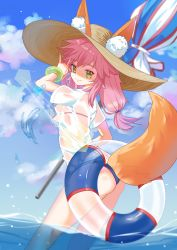 1girl absurdres animal_ears bikini blue_bikini breasts caster_(fate/extra) ears_through_headwear fate/extra fate/grand_order fate_(series) fox_ears fox_shadow_puppet fox_tail hat highres in_water large_breasts long_hair looking_afar looking_at_viewer nail_polish nature ocean parasol pink_hair see-through solo swimsuit tail tamamo_no_mae_(swimsuit_lancer)_(fate) umbrella wet wet_clothes yellow_eyes