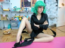 1girl black_dress cosplay curly_hair dress frown green_eyes green_hair lana_rain one-punch_man photo short_hair solo tatsumaki