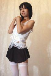 1boy asian black_hair blush crossdressing long_hair looking_at_viewer photo skirt solo thighhighs trap