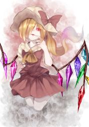 1girl ascot blonde_hair bow crystal finger_to_mouth flandre_scarlet hair_over_one_eye hat hat_bow highres looking_at_viewer ocean_(2224446) open_mouth puffy_sleeves red_eyes shirt short_sleeves side_ponytail skirt skirt_set skull solo touhou vest wings